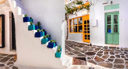 Traditional Greece, White paved narrow streets of Paros island, Cyclades. Popular touristic place in old town of Naoussa with cute shops