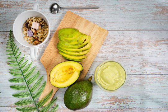 healthy eat and lifestyle with avocado slice ,smoothie and breakfast on wooden background