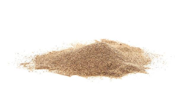 Heap of black pepper powder on white background