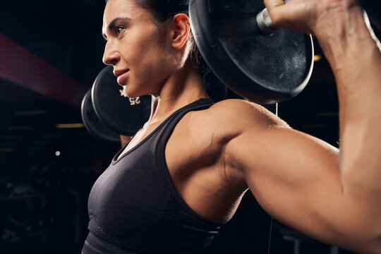 Determined young woman working out at the gym