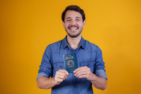 Young man holding a passport