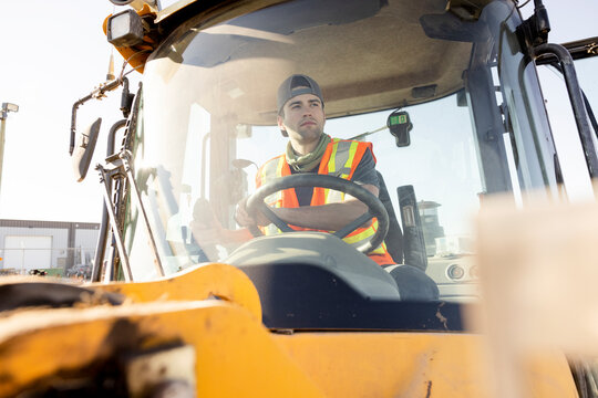 Man driving forklift in industrial yard