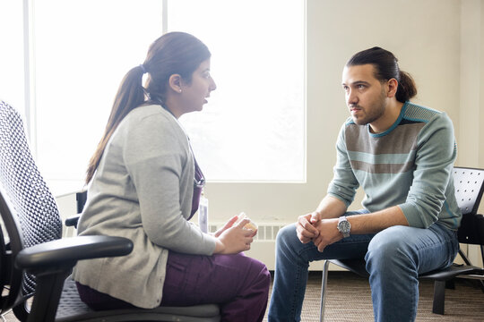 Doctor and patient talking in clinic office