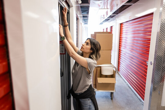 Woman opening storage facility locker