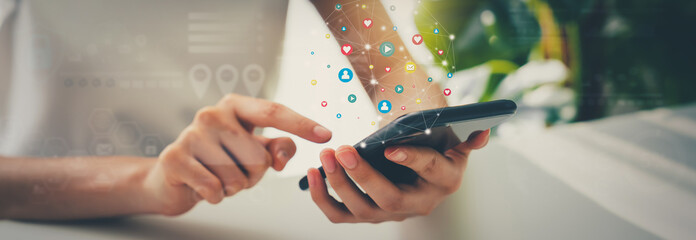 Obraz Woman hand using smartphone and show icon social media. Network technology concept. - fototapety do salonu