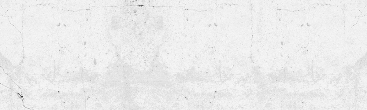 Whitewashed old concrete wall panoramic texture. White painted cracked cement slab. Light grey abstract grunge background