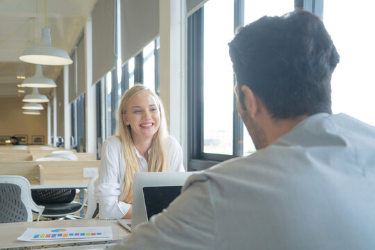 A couple of western business woman people dating, meeting, communicate, discuss documents, and working with computer laptop in office seminar with colleagues. People lifestyle. Corporate teamwork