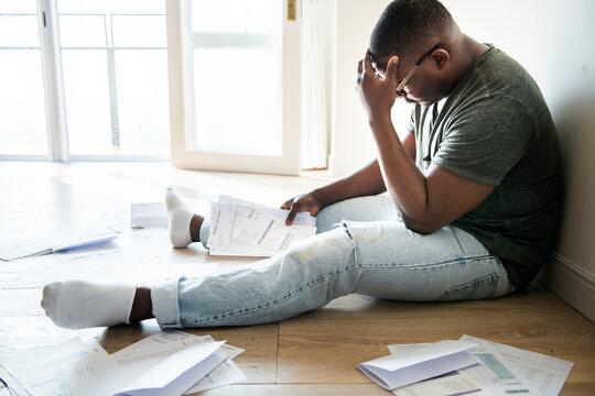Man managing the debt