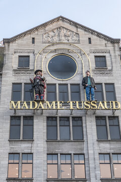 View of Amsterdam Madame Tussaud wax museum, next to Royal Palace. Museum is major tourist attraction in Amsterdam, displaying waxworks of famous figures. Amsterdam, The Netherlands. August 21, 2019.