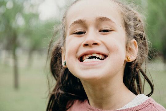 Smiling preschooler kid showing teeth