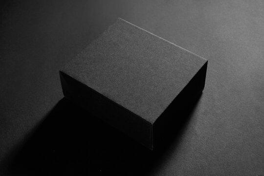 Empty black box on black background