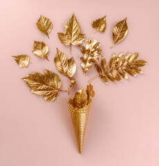 Wall Art. Botanical set. Lifestyle decoration. Gold ice cream cone with autumn gold leaves, on pink...