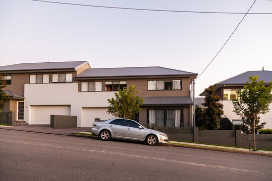 Grey car parked in front of home on sloping street in Adamstown Newcastle