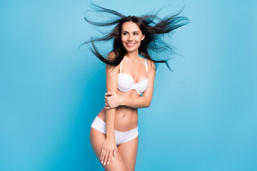 Photo of cheerful brown hairdo nice lady look empty space air blow wear white lingerie isolated on...