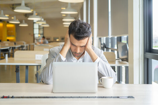Portrait of sad depress business middle east man, person thinking about problem, working online, using a computer laptop notebook, technology device. People lifestyle.