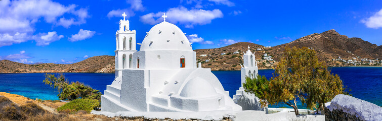 Greece travel. Stunning nature scenery and traditional churches of Cyclades, Ios island. Whitre church near the port