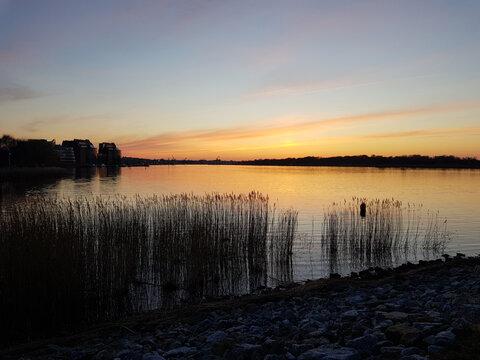 Rostock Skyline at sunset from Dierkow at the Unterwarnow Mecklenburg Western Pomerania Germany