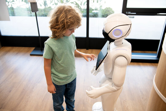 robot provide assistance to child. automation. artificial intelligence interact with boy