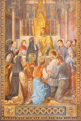 VIENNA, AUSTIRA - JUNI 24, 2021: The symbolic fresco of Jesus as the priest with the eucharist in the Votivkirche church by brothers Carl and Franz Jobst (sc. half of 19. cent.).