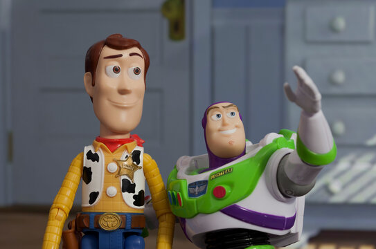 NEW YORK USA, JUNE 30 2021: recreation of a scene from Disney Pixar Toy Story with Buzz Lightyear and Woody - Disney Pixar action figure