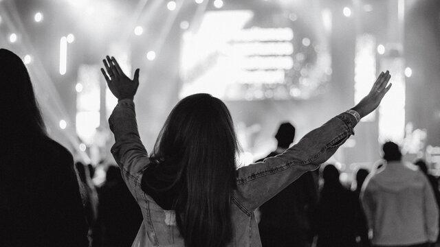 christian concert woman raised hands