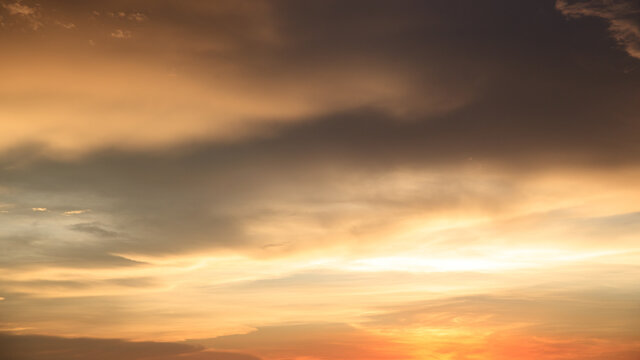 Background of orange sky and clouds with sunset light in evening at summer time when with blank copy space, showing about environment, climate concept.