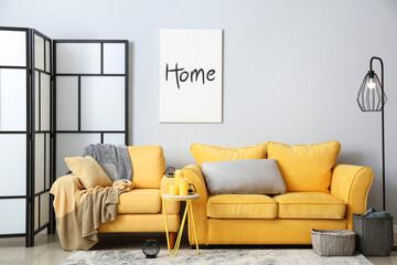 Obraz Interior of stylish living room with comfortable sofa - fototapety do salonu