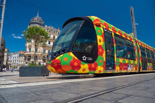 Light rail train downtown at La Place de Comédie in Montpelier France during summer