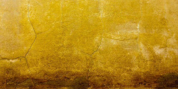 Cracked and dirty concrete wall texture. yellow-brown tone