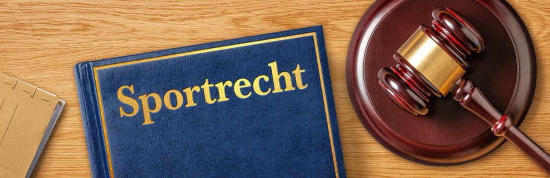 Richterhammer mit Gesetzbuch - Sportrecht