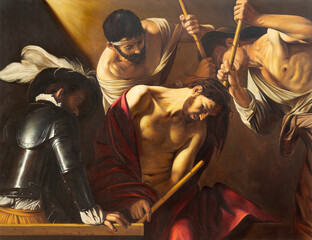 VIENNA, AUSTIRA - JUNI 18, 2021: The painting of The Crowning with Thorns in church Rochuskirche as the copy of Caravaggio by unknown artist.