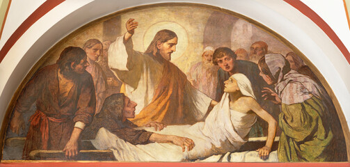 VIENNA, AUSTIRA - JUNI 18, 2021: The fresco of The Resurrection of the Young Man from Nain in Herz Jesu church from begin of 20. cent. by autor with F.Z. initials.