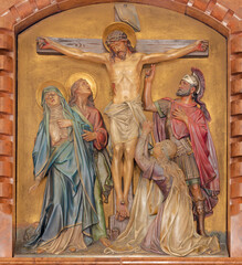 VIENNA, AUSTIRA - JUNI 18, 2021: The relief of Crucifixion in the Herz Jesu church from begin of 20. cent. by Workroom from Munich.
