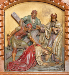 VIENNA, AUSTIRA - JUNI 18, 2021: The relief of Jesus fall under the cross in the Herz Jesu church from begin of 20. cent. by Workroom from Munich.