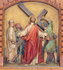 VIENNA, AUSTIRA - JUNI 18, 2021: The relief of Jesus carries his cross in the Herz Jesu church from begin of 20. cent. by Workroom from Munich.