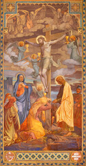 VIENNA, AUSTIRA - JUNI 24, 2021: The fresco Crucifixion in the Votivkirche church by brothers Carl and Franz Jobst (sc. half of 19. cent.).