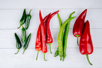 top view of green and red hot chili peppers isolated on white background