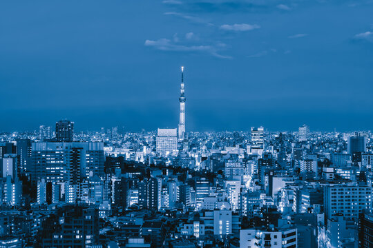 Aerial view of Tokyo Skytree. Downtown skyline, urban city in Japan. Apartments and district in smart city in Asia. High rise skyscrapers buildings at night. Architecture landscape background.