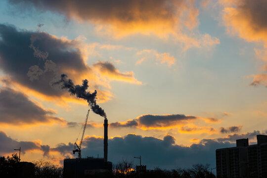 Orange sunset with smoke factory