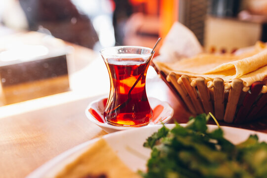 Hot traditional turkish tea placed on table