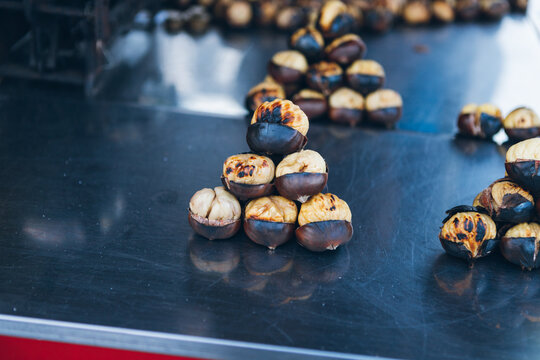 Stack of fried chestnuts on stall