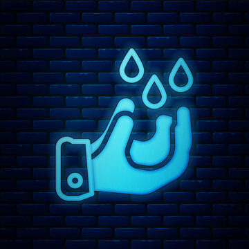 Glowing neon Wudhu icon isolated on brick wall background. Muslim man doing ablution. Vector