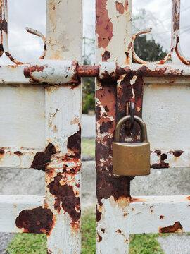 Padlock on the rustic metal gate.