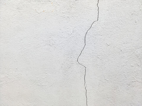 Close-up view of the cement crack wall texture background.