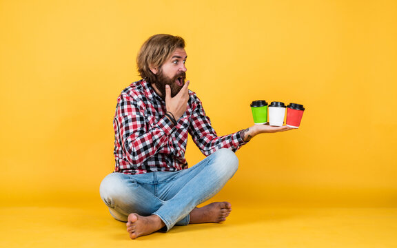 what taste is better. Handsome mature guy drinking from cup. Hold paper cup of coffee or tea. lifestyle concept. handsome hipster man with cup of take away coffee. he is taking coffee break