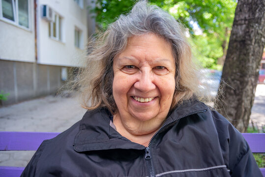 Elderly Jewish Lady Smiling Portrait Outdoors in Spring