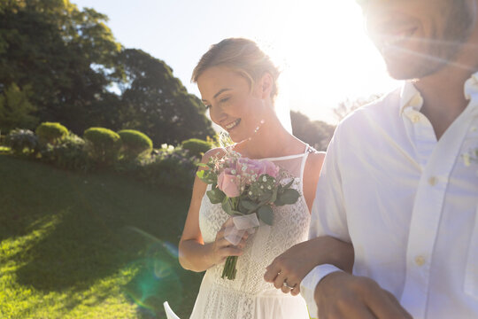 Happy caucasian bride and groom getting married and smiling