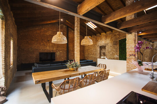 Loft style kitchen interior with furniture at home