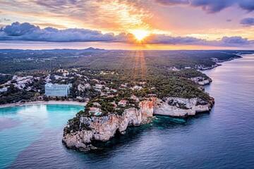 Sunrise in Cala Galdana, Menorca, Spain. view of sky, sea and sun