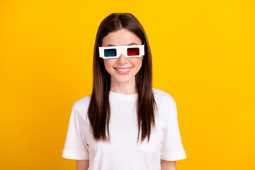 Photo of young girl happy positive smile wear 3d glasses watch movie isolated over yellow color background Wall mural